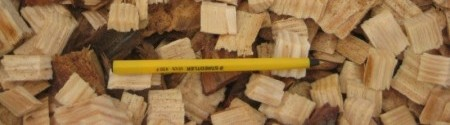 bulk-pine-wood-chips-with-pen-as-size-indicator
