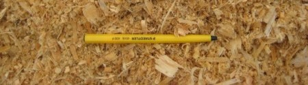 bulk-wood-shavings-with-pen-to-compare-size